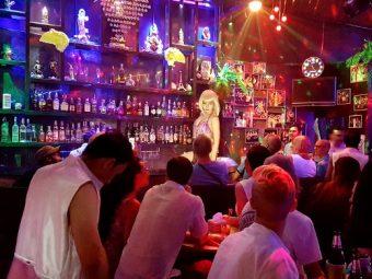 dancing on the bar at gay ram bar chiang mai